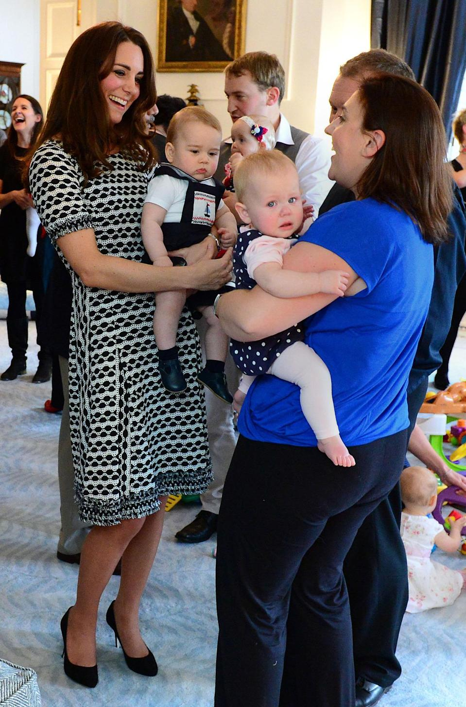 <p>Kate donned a printed knit dress by Tory Burch for Prince George's playdate. She teamed the look with simple black pumps by Jimmy Choo. </p><p><i>[Photo: PA]</i></p>