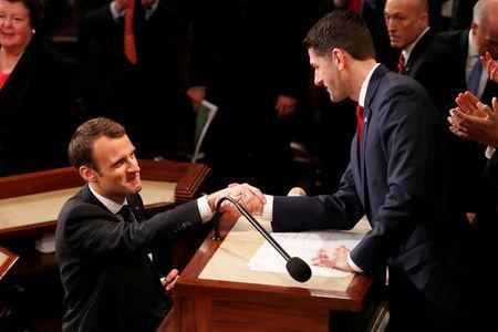 French President Emmanuel Macron is greeted by U.S. Speaker of the House Paul Ryan as he arrives to address a joint meeting of the U.S. Congress in the House chamber of the U.S. Capitol in Washington, U.S., April 25, 2018. REUTERS/Jonathan Ernst