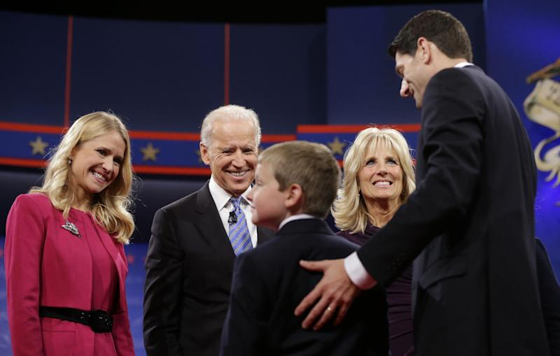Vice President Joe Biden, center, and his wife Jill Biden, meet with Republican vice presidential candidate, Rep. Paul Ryan, R-Wis., right, his wife Janna Ryan, left, and son Charlie Ryan, center, on stage after the vice presidential debate, at Centre College in Danville, Ky., Thursday, Oct. 11, 2012. (AP Photo/Pablo Martinez Monsivais)