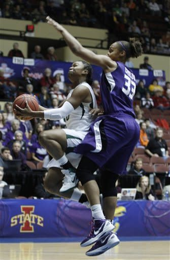 Baylor guard Odyssey Smith (0) shoots as she is defended by Kansas State forward Jalana Childs (33) in the first half of a semifinal game at the NCAA college women's Big 12 conference basketball tournament, Friday, March 9, 2012 in Kansas City, Mo. (AP Photo/Jeff Tuttle)