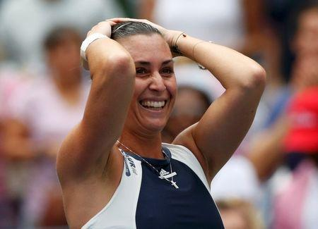 Flavia Pennetta of Italy celebrates after defeating Simona Halep of Romania in their women's singles semi-final match at the U.S. Open Championships tennis tournament in New York, September 11, 2015. REUTERS/Shannon Stapleton Picture Supplied by Action Images