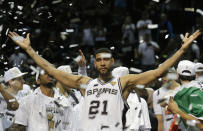 FILE - In this June 15, 2014, file photo, San Antonio Spurs forward Tim Duncan (21) celebrates after Game 5 of the NBA basketball finals in San Antonio. Kobe Bryant, Tim Duncan and Kevin Garnett. Each was an NBA champion, an MVP, an Olympic gold medalist, annual locks for All-Star and All-Defensive teams. And now, the ultimate honor comes their way: On Saturday night, May 15, 2021, in Uncasville, Connecticut, they all officially become members of the Naismith Memorial Basketball Hall of Fame. (AP Photo/David J. Phillip, File)