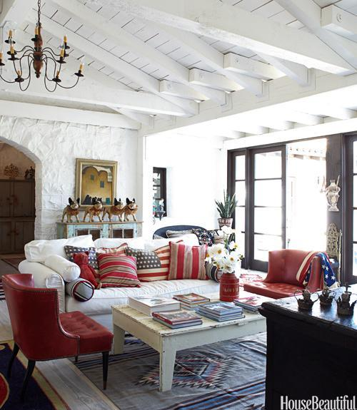 """<div class=""""caption-credit""""> Photo by: Victoria Pearson</div><div class=""""caption-title"""">American Flag Accents</div><p> The living room in designer Kelley McDowell's Ojai, California, farmhouse, is filled with American flag accessories. """"There's something about the American flag that moves me,"""" she says. """"When I look at it, I think that someone had divine intervention when they created it."""" McDowell painted the walls and ceilings the starkest white she could find: a Benjamin Moore primer, Super Spec Flat. Pillows on the living room sofa are by Laurel Adams Design; papier-mâché bulldogs, Animal Art Antiques. </p> <p> <b>See more:</b> </p> <p> <a rel=""""nofollow noopener"""" href=""""http://www.housebeautiful.com/shopping/best/4th-of-july-entertaining-ideas?link=emb&dom=yah_life&src=syn&con=blog_housebeautiful&mag=hbu"""" target=""""_blank"""" data-ylk=""""slk:11 Chic Finds for 4th of July Party"""" class=""""link rapid-noclick-resp""""><b>11 Chic Finds for 4th of July Party</b></a> <br> <br> <a rel=""""nofollow noopener"""" href=""""http://www.housebeautiful.com/decorating/home-makeovers/summer-home-decorating-ideas?link=emb&dom=yah_life&src=syn&con=blog_housebeautiful&mag=hbu"""" target=""""_blank"""" data-ylk=""""slk:50+ Easy Summer Decorating Ideas"""" class=""""link rapid-noclick-resp""""><b>50+ Easy Summer Decorating Ideas</b></a> </p>"""
