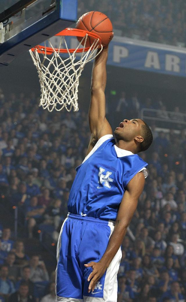 Kentucky's Aaron Harrison goes up for a dunk during the NCAA college basketball team's Big Blue Madness, Friday, Oct. 18, 2013, in Lexington, Ky.(AP Photo/Timothy D. Easley)