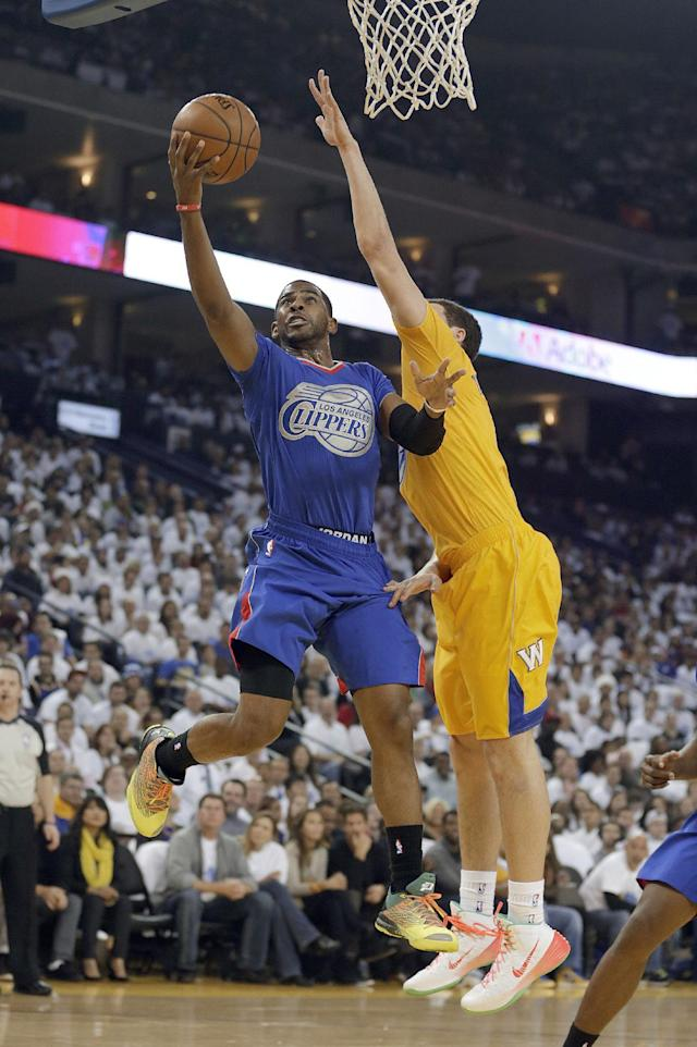 Los Angeles Clippers point guard Chris Paul (3) drives to the basket against Golden State Warriors guard Klay Thompson (11) during the first half of an NBA basketball game, Wednesday, Dec. 25, 2013, in Oakland, Calif. (AP Photo/Tony Avelar)