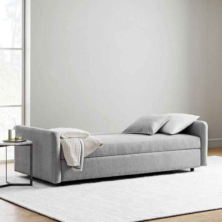 """<p><strong>West Elm </strong></p><p>westelm.com</p><p><a href=""""https://go.redirectingat.com?id=74968X1596630&url=https%3A%2F%2Fwww.westelm.com%2Fproducts%2Fclara-sleeper-sofa-h3051&sref=https%3A%2F%2Fwww.bestproducts.com%2Fhome%2Fg33012977%2Fwest-elm-summer-home-decor-sale%2F"""" rel=""""nofollow noopener"""" target=""""_blank"""" data-ylk=""""slk:Shop Now"""" class=""""link rapid-noclick-resp"""">Shop Now</a></p><p><del>$1,099—$1,499 </del><strong><br>$769.99—$1,199.20</strong></p><p>While you probably wouldn't think to replace your couch on a whim, West Elm's deals are simply too good to pass up. Plus, this option converts into a bed so your friends have a place to crash. (You know, when you can see your friends again.) </p>"""