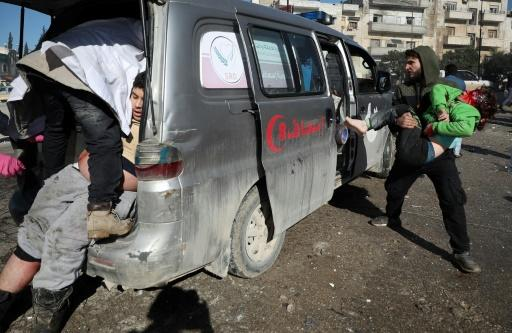 Casualties are loaded into an ambulance  following an air strike by pro-regime forces in the nothwestern Syrian city of Idlib on Saturday