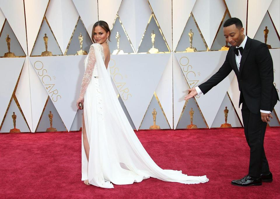 <p>Legend shows off his wife in all her glory on the red carpet at the Oscars.</p>