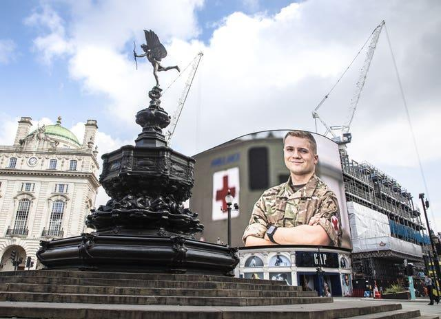 Portraits of Armed Forces personnel appeared on the billboards of Piccadilly Circus