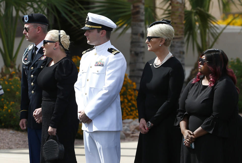 Daughter Bridget McCain, right, wife Cindy McCain, second from right, son Jack McCain, middle, daughter Meghan McCain, second from left, and Jimmy McCain, left, pause to watch as the casket of the late Sen. John McCain is moved by military pallbearers prior to a memorial service at a Phoenix church on, Aug. 30. (Photo: AP Photo/Ross D. Franklin)