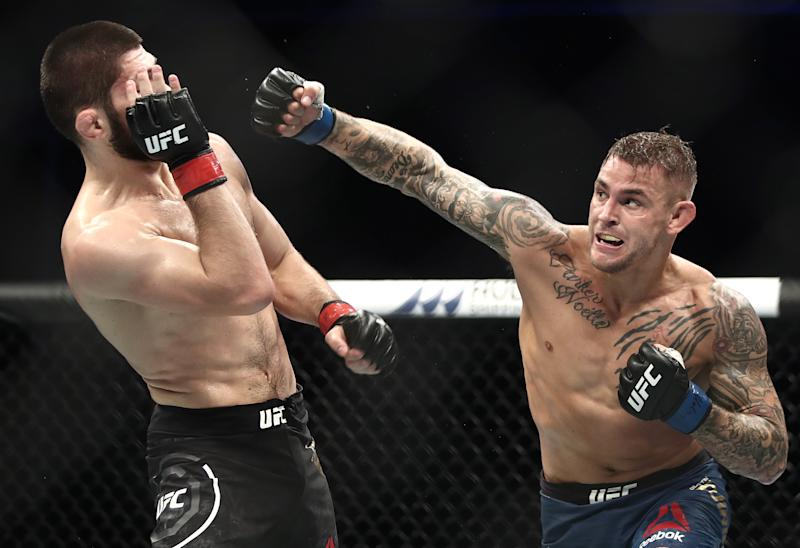 ABU DHABI, UNITED ARAB EMIRATES SEPTEMBER 7, 2019: UFC lightweight champion Khabib Nurmagomedov (L) and interim UFC lightweight champion Dustin Poirier fight in their title unification bout at the UFC 242 mixed martial arts tournament. Valery Sharifulin/TASS (Photo by Valery Sharifulin\TASS via Getty Images)