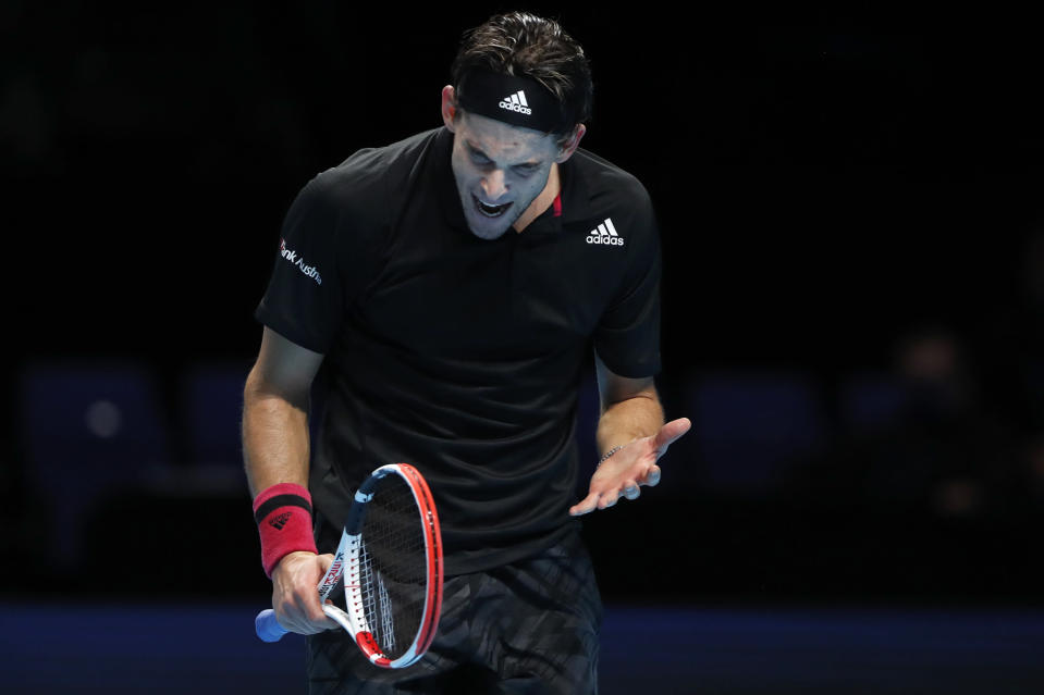 Dominic Thiem of Austria reacts after losing a point against Daniil Medvedev of Russia during their singles final tennis match at the ATP World Finals tennis tournament at the O2 arena in London, Sunday, Nov. 22, 2020. (AP Photo/Frank Augstein)