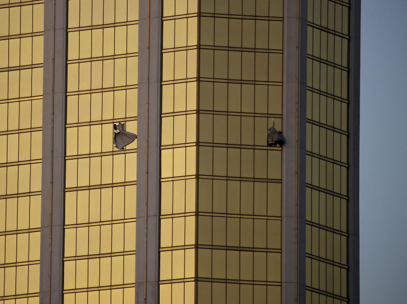 FILE - In this Monday, Oct. 2, 2017 file photo, drapes billow out of broken windows at the Mandalay Bay resort and casino on the Las Vegas Strip, following a mass shooting at a music festival in Las Vegas. Police in Las Vegas plan to release witness statements and officer reports of the Oct. 1 gunfire that killed 58 people and injured hundreds in the deadliest mass shooting in modern U.S. history. The scheduled release of documents on Wednesday, May 16, 2018, comes more than seven months after the shooting on the Las Vegas Strip. (AP Photo/John Locher, File)