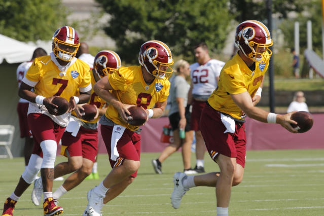 FILE - In this July 26, 2019, file photo, Washington Redskins quarterbacks Colt McCoy (12), Case Keenum (8) and Dwayne Haskins Jr. (7) run drills during the NFL football team's training camp in Richmond, Va.The three are competing to be Washington's starter. Haskins, the 15th overall pick in the draft, may not be under center Week 1 but is expected to see plenty of action. (AP Photo/Steve Helber, File)