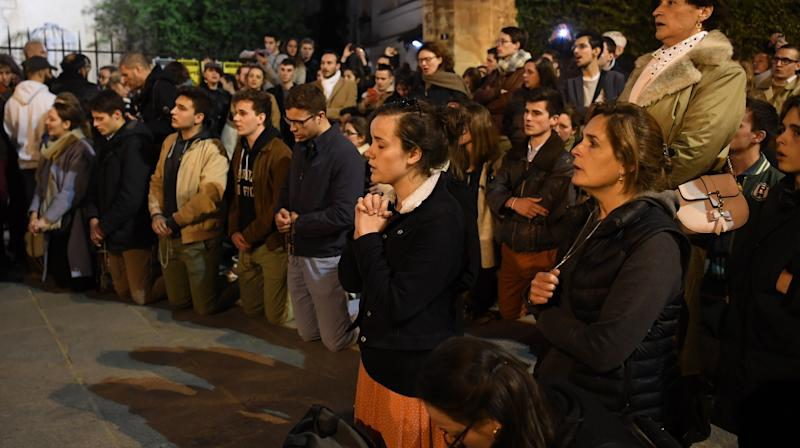 Parisians Pay Homage To Notre Dame With Catholic Hymns, Wine In The Streets