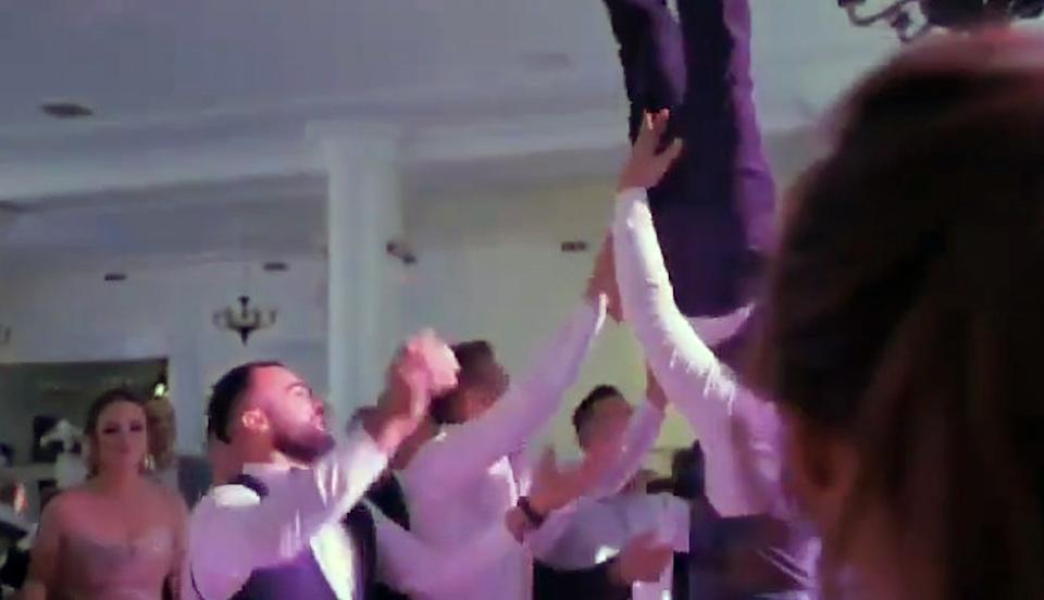 The groom being lifted in the air by his friends at his wedding reception. Source: CEN/Australscope