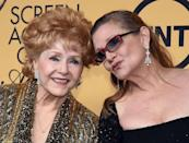 """<p><strong>Famous parent(s)</strong>: actor-singers Debbie Reynolds and Eddie Fisher <br><strong>What it was like: </strong>""""When we went out, people sort of walked over me to get to her, and no, I didn't like it,"""" Carrie once <a href=""""http://www.nytimes.com/2010/12/05/arts/television/05fisher.html"""" rel=""""nofollow noopener"""" target=""""_blank"""" data-ylk=""""slk:said"""" class=""""link rapid-noclick-resp"""">said</a>. """"I overheard people saying, 'She thinks she's so great because she's Debbie Reynolds' daughter!' And I didn't like it; it made me different from other people and I wanted to be the same.""""</p>"""