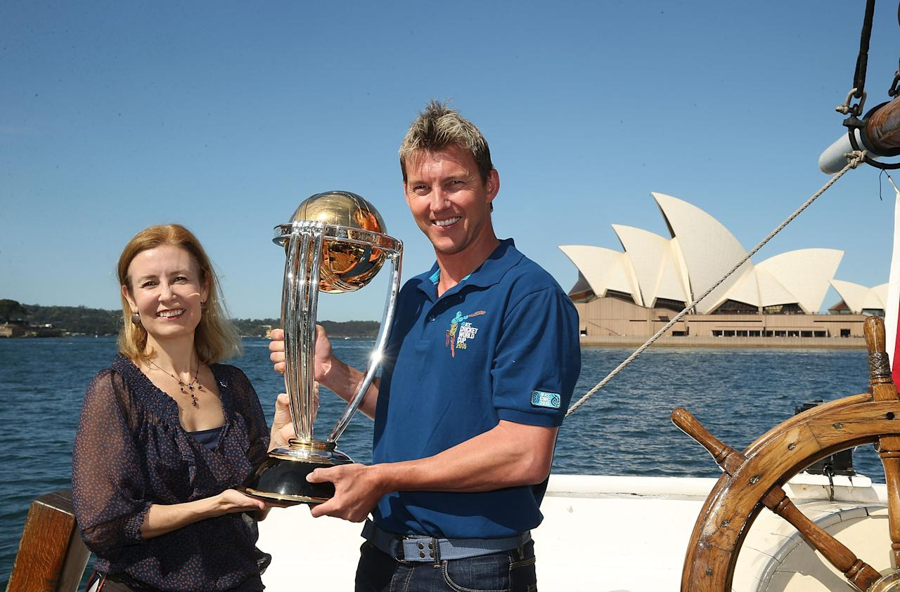 SYDNEY, AUSTRALIA - OCTOBER 02:  Brett Lee and NSW Minister for Sport Gabrielle Upton pose on Sydney Harbour with the ICC Cricket World Cup trophy during celebrations to mark 500 days to go until the 2015 ICC Cricket World Cup on October 2, 2013 in Sydney, Australia.  (Photo by Mark Metcalfe/Getty Images for the ICC)