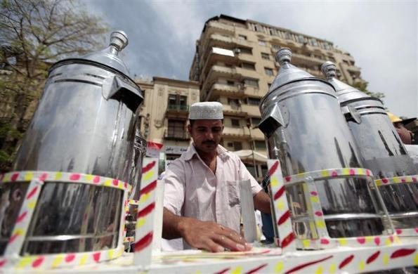 Waleed Ahmed el-Sayed, 31, who received a BA in social services from Assyiut University in 2004, sells juice in Tahrir square in Cairo, May 4, 2012. Waleed has been working as a street vendor for almost seven years as he has not found a steady job since his graduation.