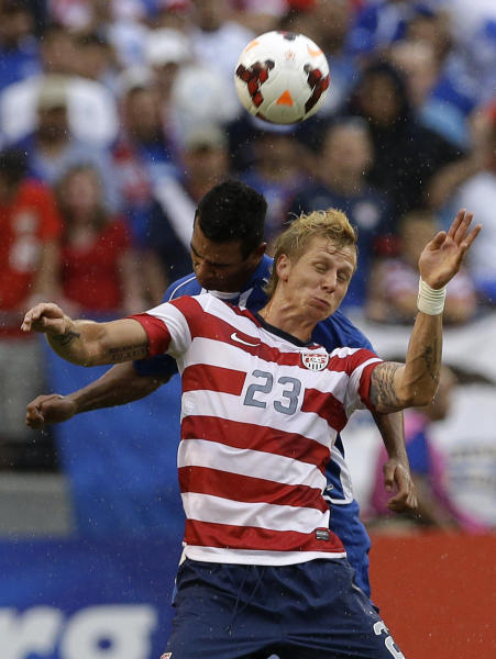 United States' Brek Shea (23) heads a ball in front of El Salvador's Xavier Garcia Orellana during the second half in the quarterfinals of the CONCACAF Gold Cup soccer tournament on Sunday, July 21, 2013, in Baltimore. The United States won 5-1. (AP Photo/Patrick Semansky)