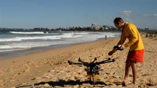 Students have developed a potentially lifesaving drone which carries a floating device above released via a remote control to a swimmer in distress. Photo: 7News