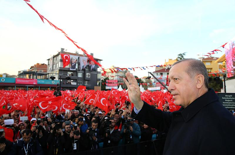 The President greets his supporters during an opening ceremony of a new metro line in Istanbul on 15 December: Reuters