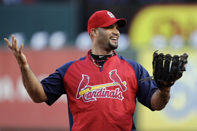 St. Louis Cardinals' Albert Pujols prepares for Game 4 of baseball's World Series, against the Texas Rangers  Sunday, Oct. 23, 2011, in Arlington, Texas. (AP Photo/Tony Gutierrez)