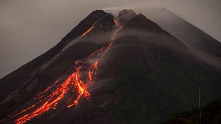 Lava flows down side of volcano