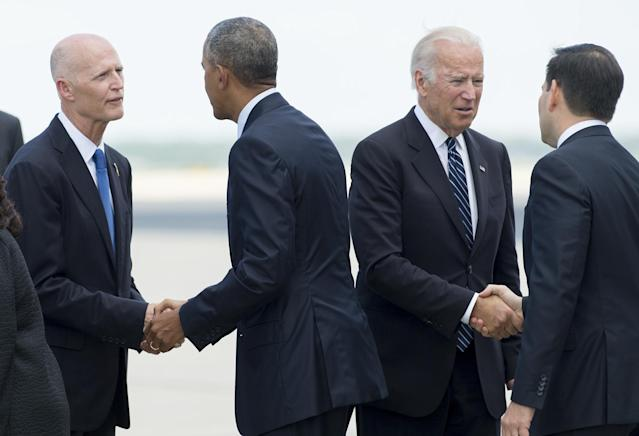 <p>President Obama shakes hands with Florida Gov. Rick Scott and Vice President Joe Biden shakes hands with Florida Sen. Marco Rubio, June 16, 2016. Saul Loeb/AFP/Getty Images) </p>