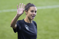 NJ/NY Gotham FC's Carli Lloyd waves to young fans before the team's NWSL soccer match against the Washington Spirit on Wednesday, Oct. 6, 2021, in Chester, Pa. (Charles Fox/The Philadelphia Inquirer via AP)