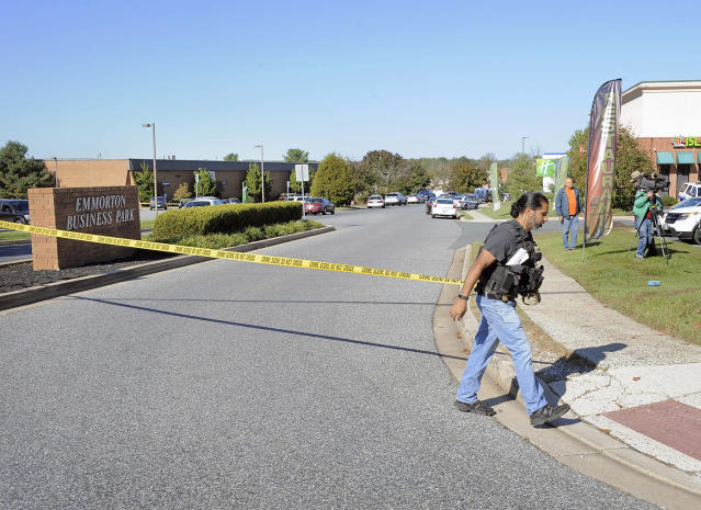 <p>A police officer puts up crime scene tape at the scene of shooting at Emmorton Business Park, the scene of a workplace shooting where five people were shot and three are confirmed dead Wednesday, Oct. 18, 2017 in Edgewood, Md. (Photo: Kenneth K. Lam/Baltimore Sun/TNS via Getty Images) </p>