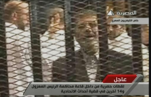 An image grab from Egyptian state TV shows ousted Egyptian president Mohamed Morsi in court on November 4, 2013, in Cairo