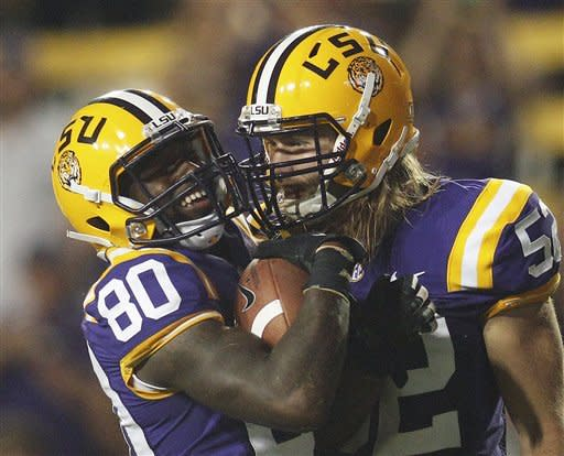 LSU's Jarvis Landry (80) is congratulated by Luke Muncie (52) after Landry recovered a Towson fumble on a punt return in the second half of an NCAA college football game in Baton Rouge, La., Saturday, Sept. 29, 2012. (AP Photo/Bill Haber)