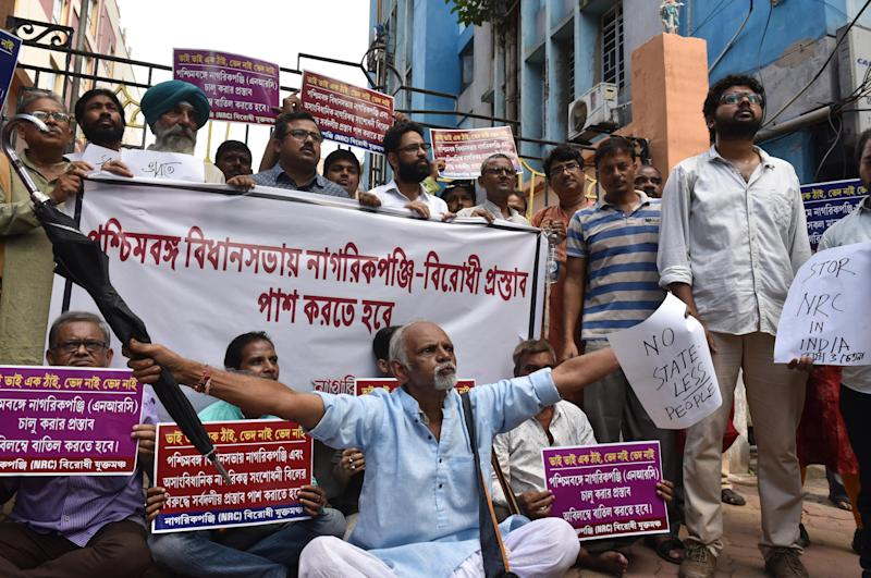 KOLKATA, INDIA - SEPTEMBER 2: Demonstrators from the Joint Forum Against NRC during a sit in protest against the National Register of Citizens (NRC) list released in Assam which excluded over 19 lakh people, in front of Assam House on September 2, 2019 in Kolkata, India. A total of 3,11,21,004 persons are found eligible for inclusion in final NRC in Assam, leaving out 19,06,657 persons, including those who did not submit their claims. The list is aimed at segregating Indian citizens living in Assam from those who had illegally entered the state from Bangladesh. (Photo by Samir Jana/Hindustan Times via Getty Images)