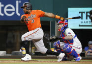 Baltimore Orioles' Maikel Franco follows thru on a base hit against the Texas Rangers during the fifth inning of a baseball game in Arlington, Texas, Saturday, April 17, 2021. (AP Photo/Ray Carlin)