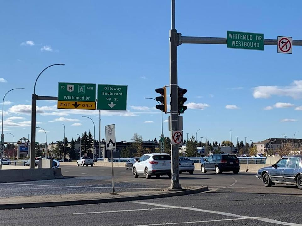Two people were killed and one seriously injured when a vehicle fleeing from a police stop hit a light pole near Calgary Trail and Whitemud Drive early Monday. (Jamie McCannel/CBC - image credit)