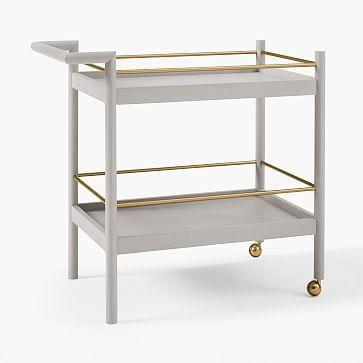 """<p><strong>West Elm</strong></p><p>westelm.com</p><p><a href=""""https://go.redirectingat.com?id=74968X1596630&url=https%3A%2F%2Fwww.westelm.com%2Fproducts%2Fmid-century-bar-cart-pebble-h5330&sref=https%3A%2F%2Fwww.housebeautiful.com%2Fshopping%2Fg33337693%2Fwest-elm-is-having-a-huge-summer-saleheres-what-to-buy%2F"""" rel=""""nofollow noopener"""" target=""""_blank"""" data-ylk=""""slk:Shop Now"""" class=""""link rapid-noclick-resp"""">Shop Now</a></p><p><del>$399</del><strong><br>$319.20</strong></p><p>Want to spruce up your virtual happy hours? This sleek bar cart as plenty of space to stow all your cocktail accoutrements.</p>"""