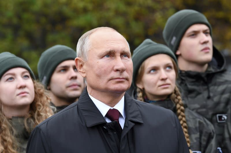 FILE PHOTO: Russian President Putin attends a ceremony at the monument of Minin and Pozharsky, marking the National Unity Day, in Moscow