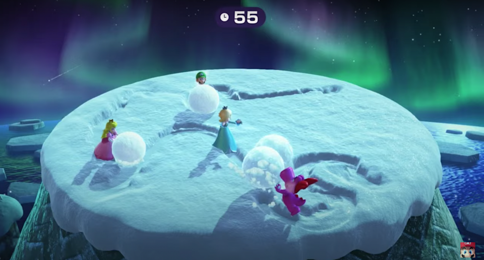 Mario Party characters push big snowballs on the top of a mountain.