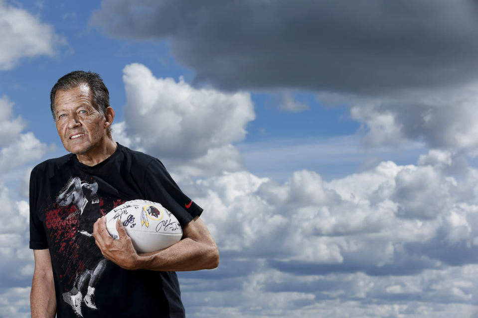 Donald Wetzel Sr., holds an autographed Washington Redskins football. Wetzel, a member of the Blackfeet nation, is proud of the Washington Redskins logo that his father Walter designed in the 1960s. (Larry Beckner/Getty Images)