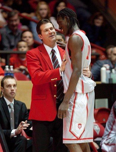 New Mexico head basketball coach Steve Alford, front left, talks with guard Tony Snell during the second half of an NCAA college basketball game against Fresno State, Saturday, Jan. 12, 2013, in Albuquerque, N.M. New Mexico won 72-45. (AP Photo/Eric Draper)
