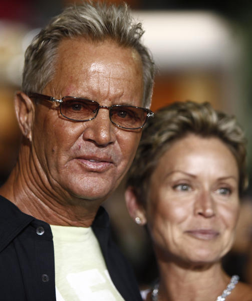 """FILE - In this Aug. 27, 2009 file photo, Director David R. Ellis, left, and his wife, Cindy, arrive at the premiere of """"The Final Destination"""" in Los Angeles. The """"Snakes on the Plane"""" director, Ellis, has died at age 60. His manager, David Gardner, confirmed his death Monday, Jan. 7, 2013, but declined to provide additional details. (AP Photo/Matt Sayles, File)"""