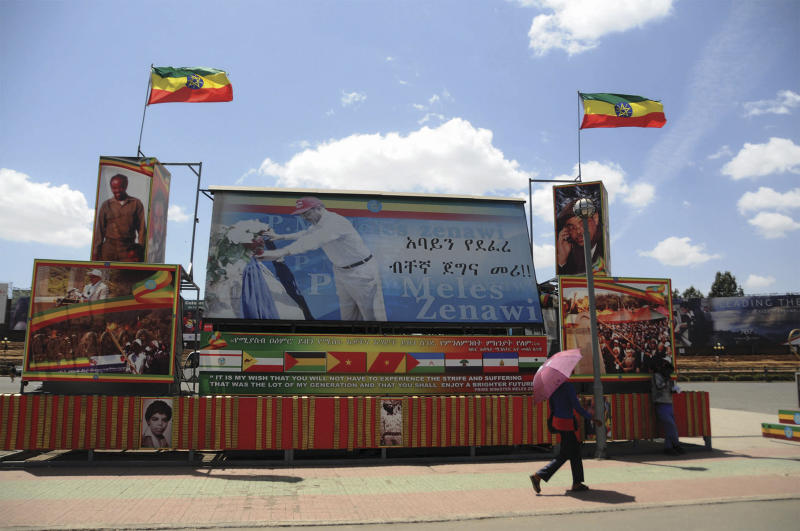 Friday Feb. 22, 2013 photo of large posters of late Prime Minister Meles Zenawi in one of the street in Addis Ababa. If you look around Ethiopia's capital, it would be hard to know that Meles Zenawi died six months ago. His pictures are posted everywhere and his successor is vowing to implement his vision without any alternations. Ethiopian leaders are having a hard time moving past Meles, a man who ruled this country for two decades. (AP Photo/Elias Asmare)