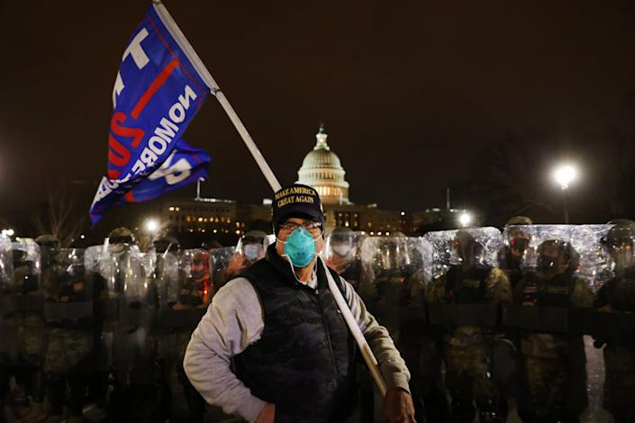 "Members of the National Guard and the Washington D.C. police keep a small group of demonstrators away from the U.S. Capitol on January 06, 2021 in Washington, DC.<span class=""copyright"">Spencer Platt/Getty Images</span>"