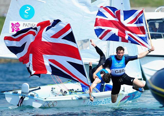 WEYMOUTH, ENGLAND - AUGUST 10: Luke Patience (L) and Stuart Bithell (R) of Great Britain celebrate finishing second and winning the silver medal in the Men's 470 Sailing on Day 14 of the London 2012 Olympic Games at the Weymouth & Portland Venue at Weymouth Harbour on August 10, 2012 in Weymouth, England. (Photo by Laurence Griffiths/Getty Images)