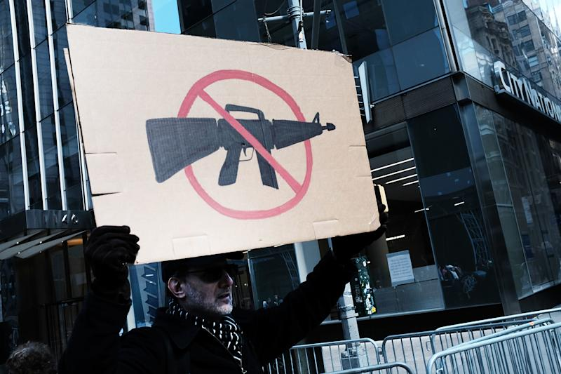 Banning assault-style weapons, which this protester may well support, is not one of the areas in which gun owners and non-gun owners agree. (Spencer Platt via Getty Images)