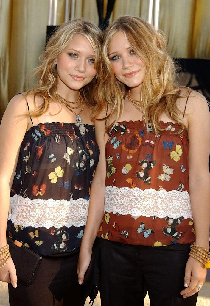 """<p>Almost a decade later, the Olsen twins were still setting hair trends. Mary-Kate and Ashley's """"beach wave"""" period was a big one and resulted in many curling iron burns over here.</p>"""