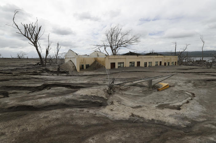 The remains of the Alas-as elementary school is seen buried in volcanic ash at Taal volcano almost a year after it erupted, on Sunday, Jan. 10, 2021 in Batangas province, Philippines. A popular tourist destination just south of Manila because of its picturesque setting in the middle of a lake, Taal erupted on Jan. 12, 2020. The eruption displaced thousands of villagers living near the area and delivered an early crisis this year for one of the world's most disaster-prone nations a couple of months before the COVID-19 pandemic broke in the country. (AP Photo/Aaron Favila)