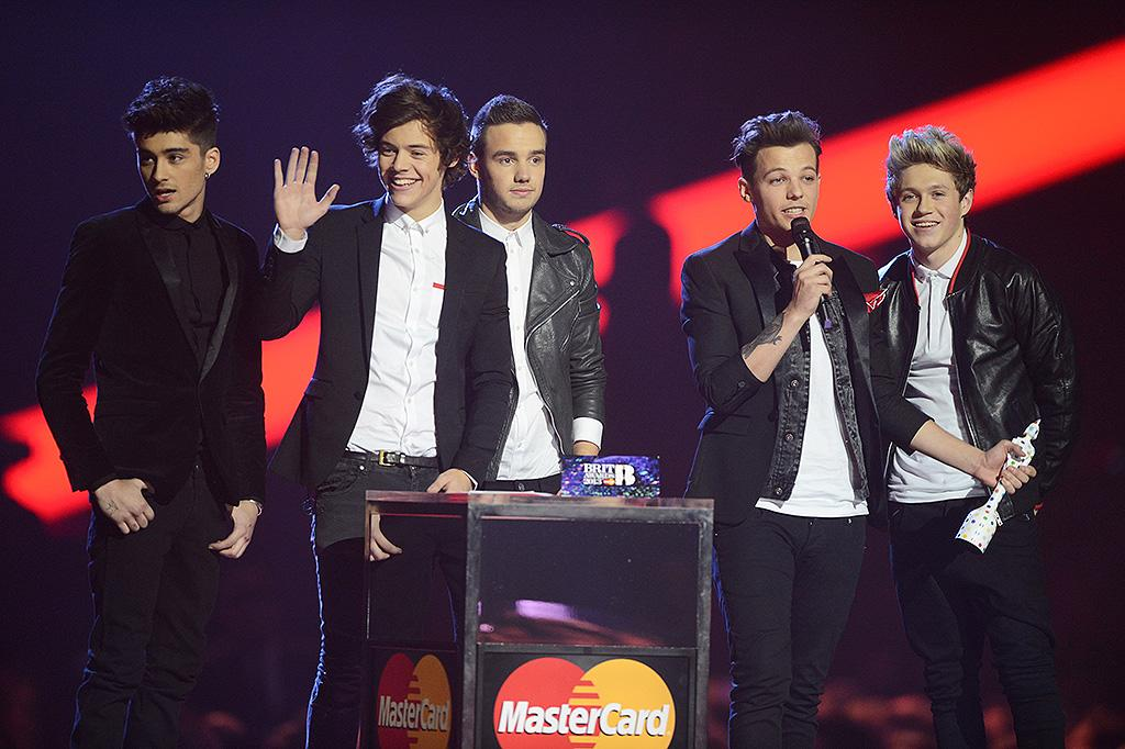 LONDON, ENGLAND - FEBRUARY 20: Liam Payne, Louis Tomlinson, Zayn Malik, Harry Styles and Niall Horan of One Direction accept their Global Success Award at The Brit Awards 2013 at The O2 Arena on February 20, 2013 in London, England. (Photo by Dave J Hogan/Getty Images)