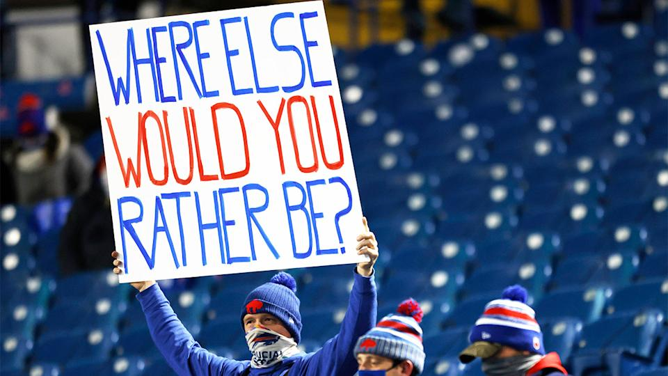 A Buffalo Bills fan holds up a sign in a near empty stadium during the Covid-19 pandemic.